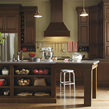 Kitchen featuring an island that has dual purpose for storage and seating