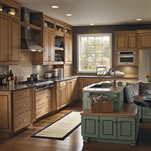 Kitchen cabinets featuring two different finishes