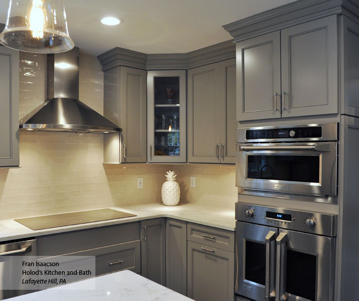 Gray cabinets with a dark blue kitchen island