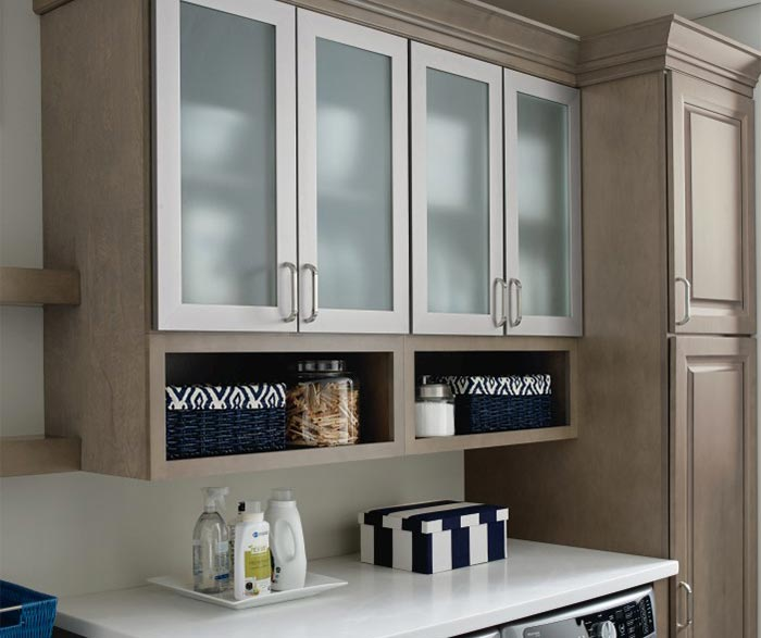 Laundry room storage cabinets with aluminum frame doors and frosted glass