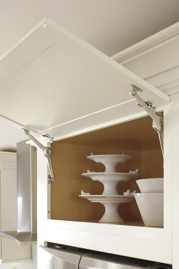 Wall cabinet with top hinge door